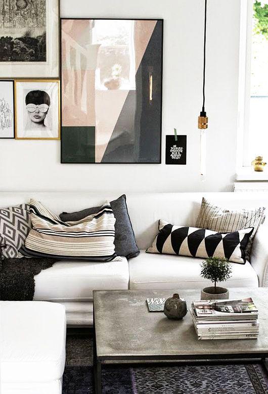 neutral low sofa with modern living room decor via purple area. / sfgirlbybay