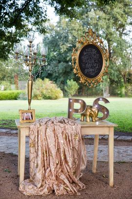 Unique Wedding Ideas - The warmest welcome for the guests, with a personal note on a vintage chalkboard, golden candelabras, a photo frame and the initials of the bride and groom | WedMeGood #wedmegood #unique #weddingideas