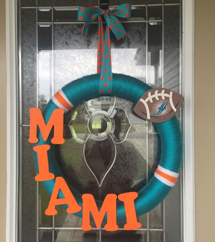 Miami Dolphins Wreath by TheTNtwoShop on Etsy https://www.etsy.com/listing/247379835/miami-dolphins-wreath
