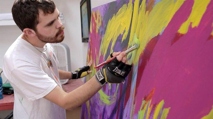 Image: Autistic artist Jeremy Sicile-Kira works on a painting at his San Diego studio.