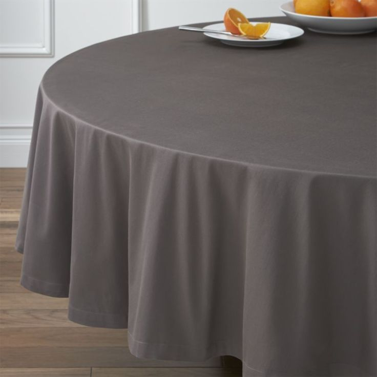 """Soft cotton round grey tablecloth is handsomely finished with 1"""" hem and mitered corners. Gorgeous grey tones of saturated color mix and match with any number of table linens."""