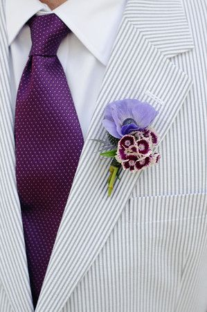 A groom in a seersucker suit always looks great, and the purple tie and boutonniere were fresh touches    Image by Daniel Taylor Photography