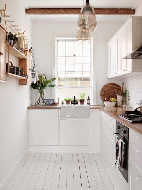 Bright white Scandinavian-style kitchen in Australia. #kitchendesign #modernkitchen #smallkitchen #galleykitchen