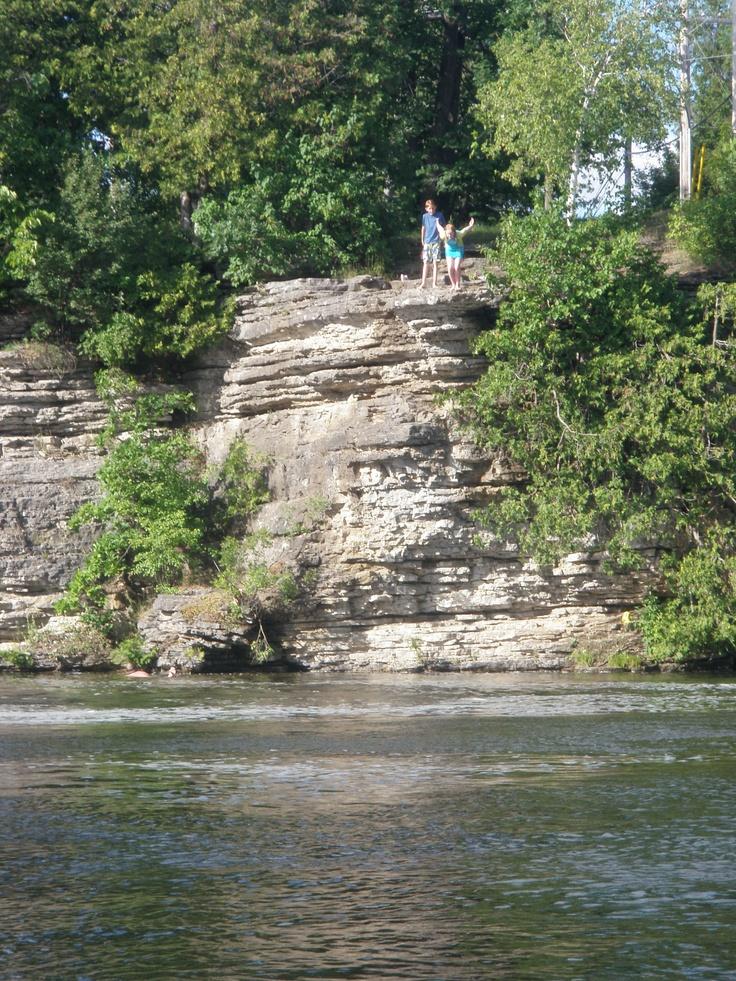 Paisley jumping off a 15-20 foot cliff in Fenelon Falls, Ontario.  #Lindsay-FenelonFalls #MLI #ESL #LearnEnglish #Canada #ON #Homestay #StudyinCanada