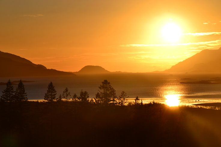 Sunset among mountains and fjords. Beauty of Northern Norway.