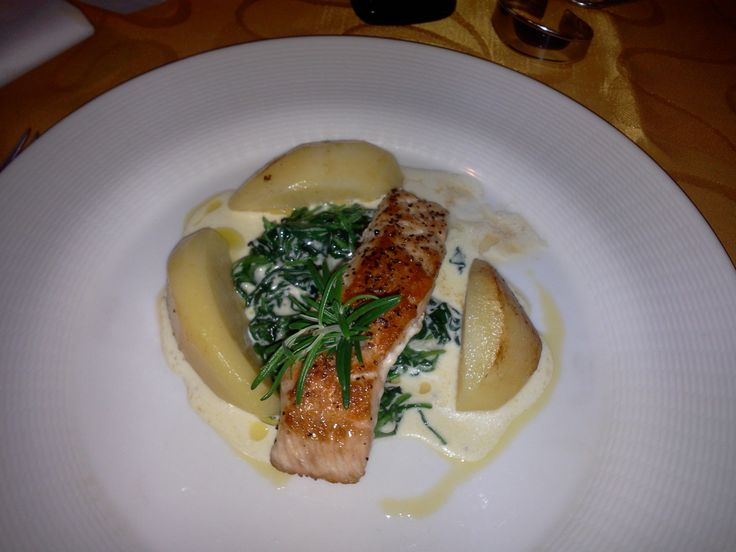 Grilled salmon filet served on cream leaf spinach, buttery potatoes