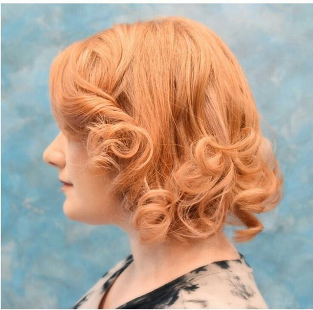 Rose goldhair color styled with pinup-style curls by Aveda Artist Molly Euphoria.