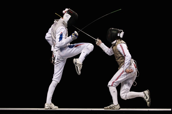 Keith Cook (R) of Great Britain in action against Brice Guyart of France during the Men's Foil Team Bronze Medal match at the Fencing Invitational, part of the London Prepares series at ExCel on November 27, 2011 in London, England