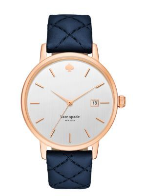 the spirited grand metro watch is designed to take you uptown, downtown and everywhere in between. a quilted navy leather strap anchors the sleek rose gold-tone case and vertical brushed silver dial.