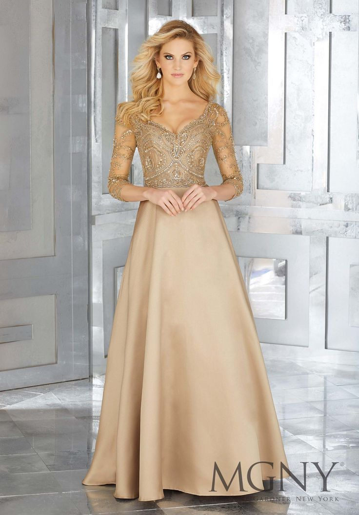 MGNY | Madeline Gardner, Evening Dress style 71607. Stunning Gold Larissa Satin Special Occasion Dress with Long Sleeves and Sweetheart Crystal Beaded Sparkly Bodice. Crystal Beaded A-Line Net with Larissa Satin. Colors Available: Black, Bronze Champagne Gold. Perfect for any Fall or Winter Formal event including a Military Ball and Mother of the Bride.