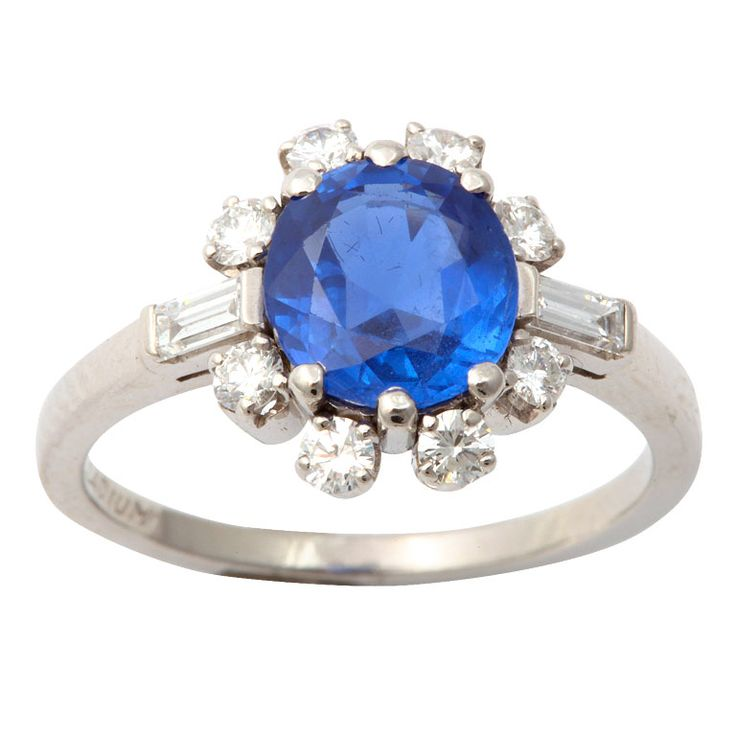 Faceted Oval Sapphire & Diamound Ring 1950's Beautiful Oval Blue Sapphire Ring set in Palladium with 2 Diamond Baguettes & 8 Full Cut clean & white Diamonds. Numbered 263479 & signed with unknown Maker's mark (Infinity symbol within an Omega symbol). Sapphire approximately 3cts.  Price $3750