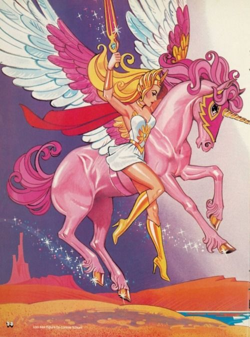 SHE-RA Princess of power...loved her and he man...i ha both figurines and they were a part of my barbie family,lol!!