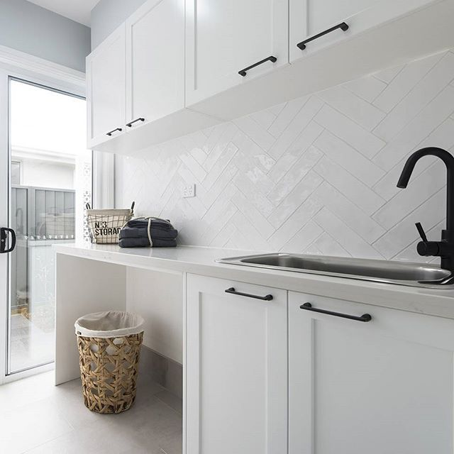 A white textured overlay to bring the hamptons to life in the laundry. Also admire the matte black tapware and handles for a a bold yet beautiful contrast. #Inspiration32 #Calderwood