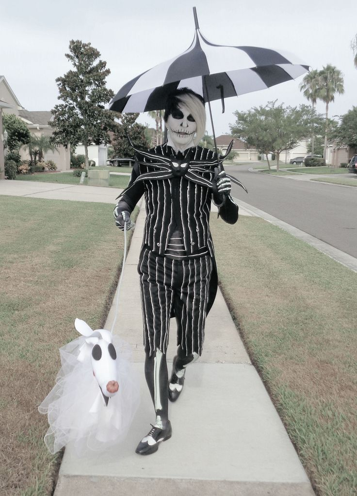 Jack Skellington walking Zero down the street ....Thirl Hupp in costume and full designer ....See me on Face Book too