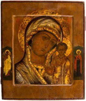 A RUSSIAN ICON OF THE KAZANSKAYA MOTHER OF GOD, c19TH.  Both depicted in richly ornamented robes, the Holy Virgin and Christ Child are flanked by the Guardian Angel and Saint Olga of Kiev.