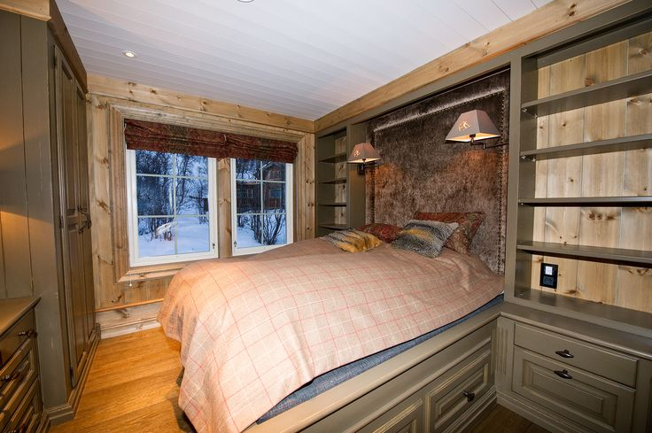 Bed that goes from wall to wall. Bedside tables and shelves on each side, drawers for storage under the bed and padded headboard. Wardrobe and dresser on the opposite side of the room in the style of the bed. Hand-crafted and hand-painted by Os Trekultur.