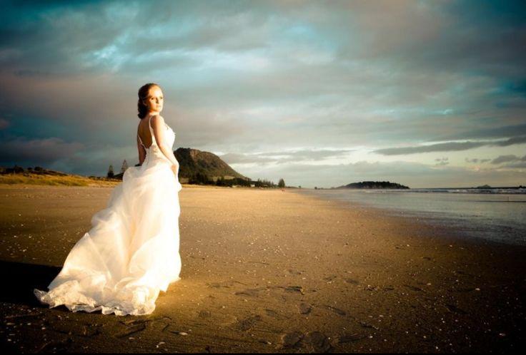TCM Photography. Wedding photography. Stunning dress on the English beach