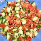 Fava bean salad with cucumbers, tomatoes, and red onion.