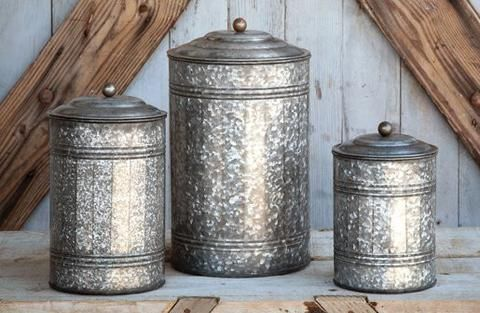 Every farmhouse kitchen needs a set of these Tall Galvanized Canisters! These canisters are perfect to store goodies or organize your kitchen spatulas and accessories! - Constructed from galvanized me