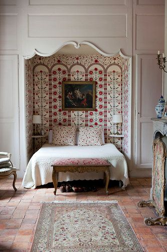 bedroom with wallpapered alcove--what a neat idea.  If you bought a wardrobe, you could do it in a closet.