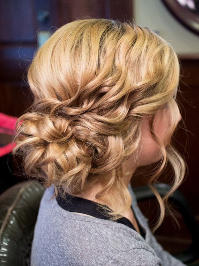 Flaunt your hair's texture with a curly side bun.