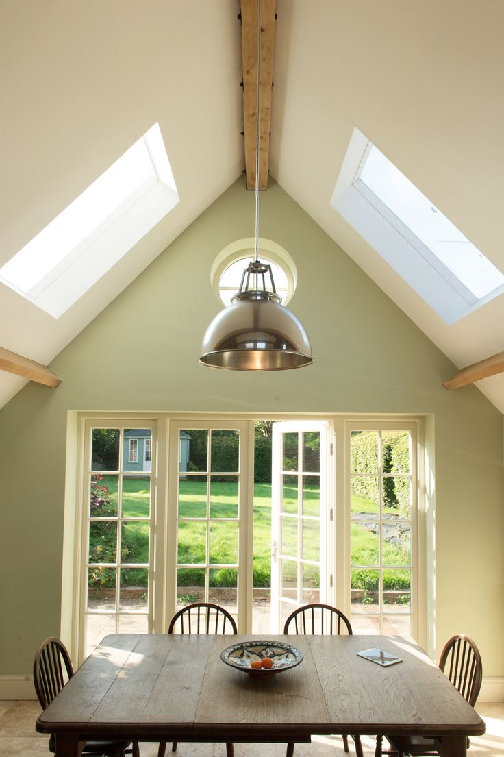 Vaulted ceilings, Farrow and Ball cooking apple green. Designed by Absolute Architecture http://www.absolute-architecture.co.uk/