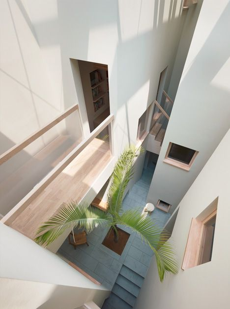 plaza home vertical view Slim Corridors & Courtyard Open Up Narrow Japanese Residence other ideas