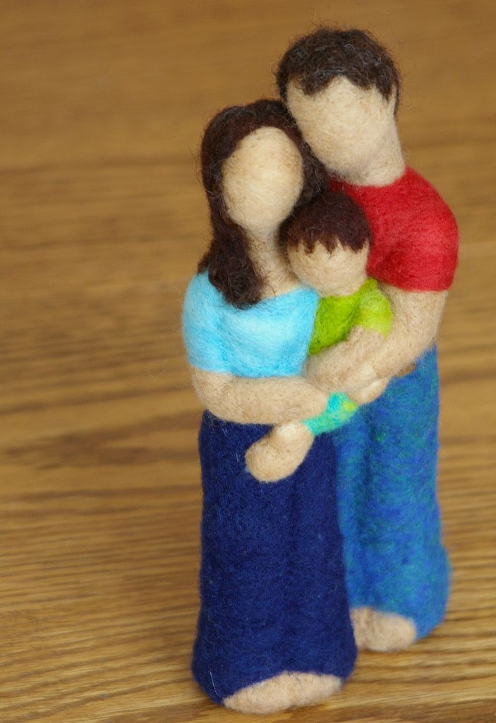 """Approx 7"""" tall, featuring mother, father and child.  Completely felted by needlefelteing"""