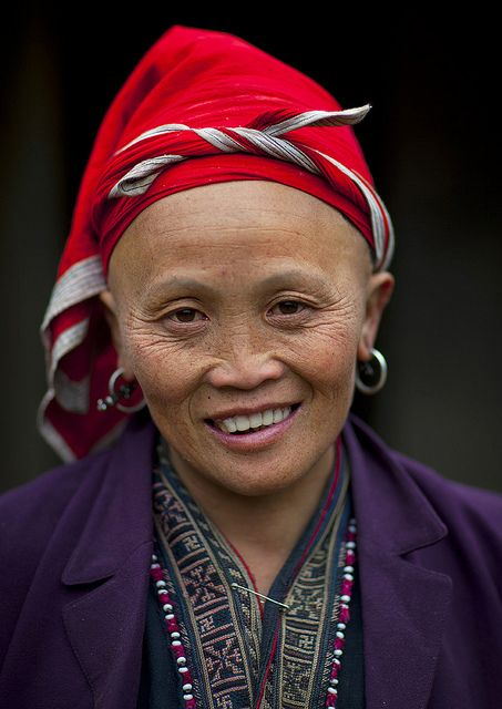 Red Dzao woman - Vietnam - They  shave off their eyebrows and foreheads as this is traditionally regarded as a sign of beauty. Photo by Eric Lafforgue