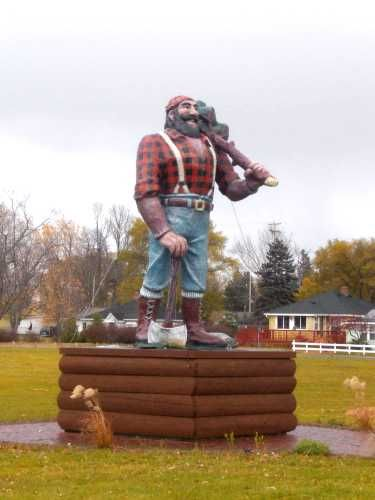 Paul Bunyan Statue, Oscoda, Michigan.  Though Paul is a legendary lumberjack, none of his stories were published until 1906.  That year, the first printed story about him was written by Oscoda Press writer James MacGillivray.  The statue is located in front of Furtaw Field (also known as Paul Bunyan Park).