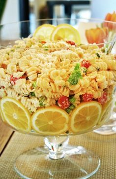 Lemon Pasta Salad This looks SO pretty!Even using your regular recipe macaroni,pasta or chick salad serving in a bowl with these lemon slices makes it really lovely!