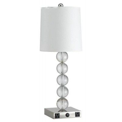 Guestroom Table Light Has Convenience Outlets On The Base.