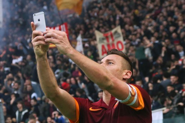 AS Roma's Francesco Totti takes a selfie as he celebrates after scoring his second goal against SS Lazio