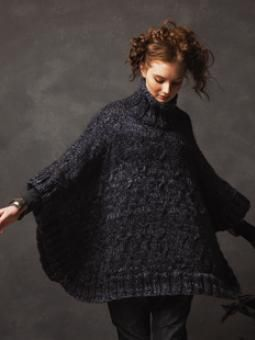 Comfort poncho with cabling detail, in Rowan's Winter Drift brochure