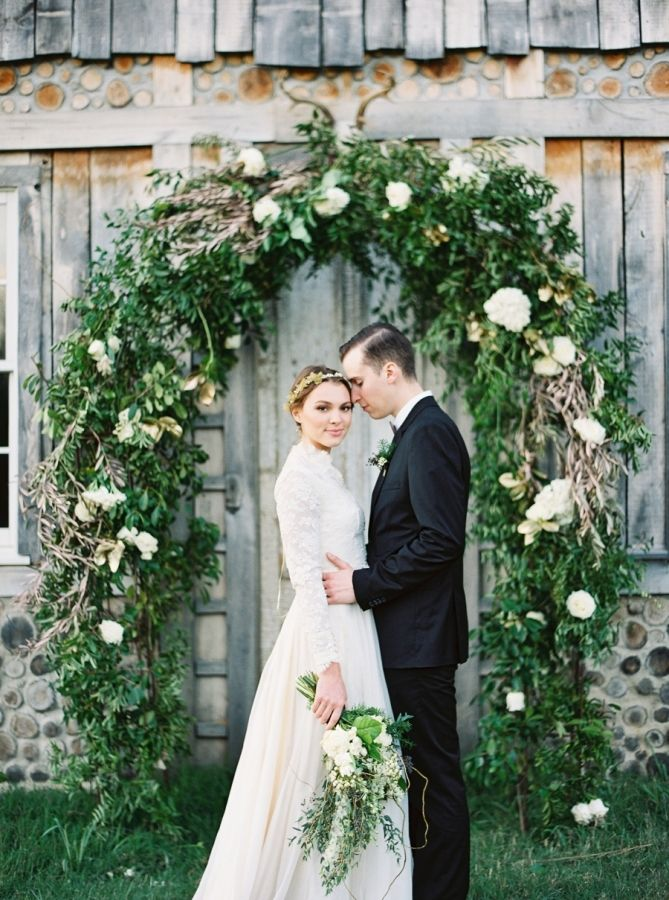 The prettiest floral arch: http://www.stylemepretty.com/2015/12/23/black-gold-holiday-wedding-inspiration/   Photography: Julie Paisley - http://juliepaisleyphotography.com/blog/