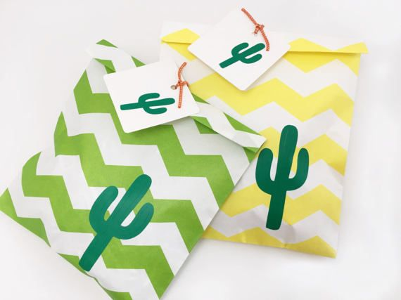Cactus Favor Tags - Set of 12  Use these tags to add extra special details to your party decor! These adorable favor bag tags are the perfect size for attaching to your treat bags, gifts, goodie bags, party favors, and much more. Each square tag measures 2.5 x 2.5, and is white with a green vinyl cactus decal. These tags come with a hole, ready for hanging! Sold in sets of 12. Twine and bags are not included with this listing.  Treat bags, cutlery, straws, and other coordinating items are…