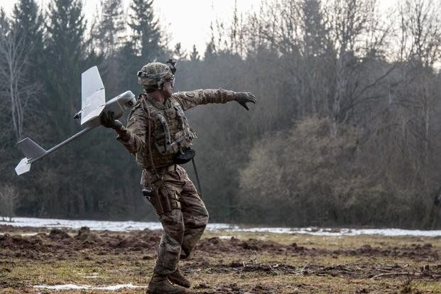 Spc. William Ritter, a military policeman with 287th Military Police Company, 97th Military Police Battalion, 89th Military Police Brigade, Fort Riley, Kansas, prepares to launch the RQ-11 Raven, small unmanned aerial system (SUAS), into the air during Allied Spirit VIII at Hohenfels, Germany, Jan. 26, 2018. (Dustin D. Biven/U.S. Army)