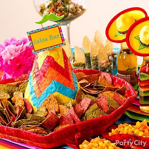 Fun salsa bar idea: Serve tortilla chips in a sombrero piñata! Click for more Cinco de Mayo party ideas!