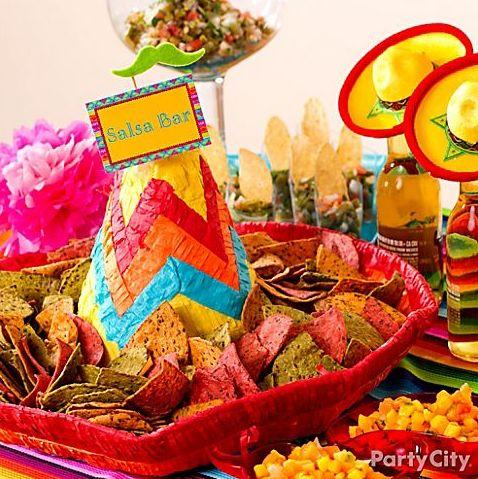 Fun salsa bar idea: Serve tortilla chips in a sombrero piñata! Click
