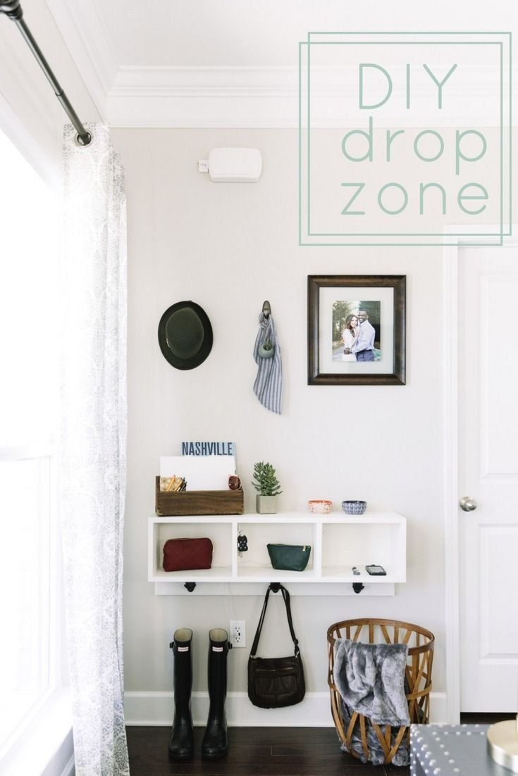 a simple shelf with clean lines cubbies and strategically placed hooks will