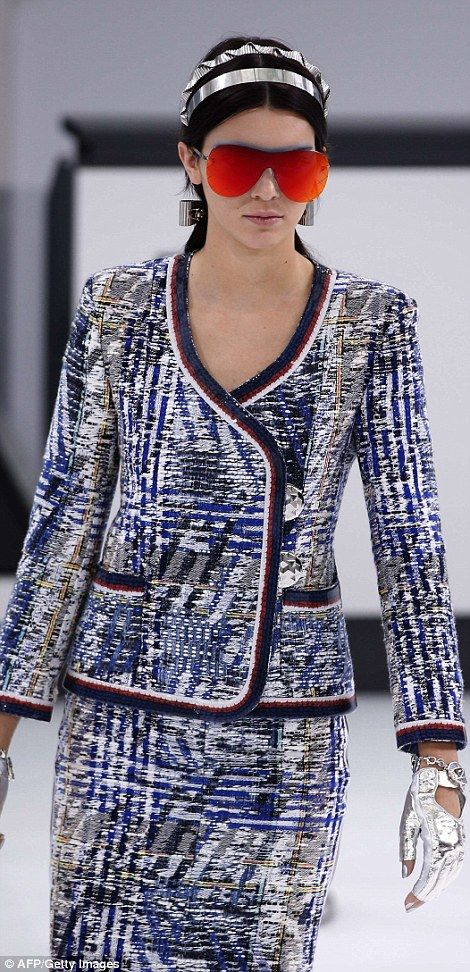 Air hostess: Kendall was decked out in a smart tweed blazer with a sequinned hem and a mat...