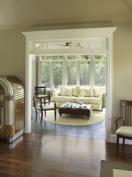 sunroom with ceiling fan and floor to ceiling windows.  I would like pocket doors between the house and sunroom.