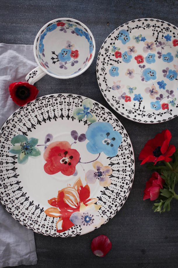 The Anthropologie EU Isidre Dinnerware collection inspired by Southern Spain. The wild flowers look great with bright Mediterranean dishes.