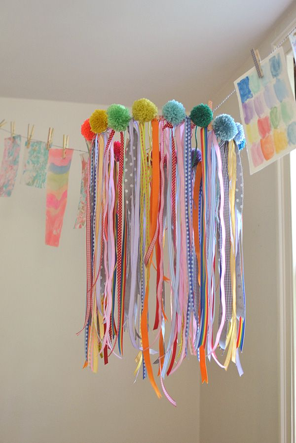 Make a chandelier for your child's room using ribbon and pompoms.