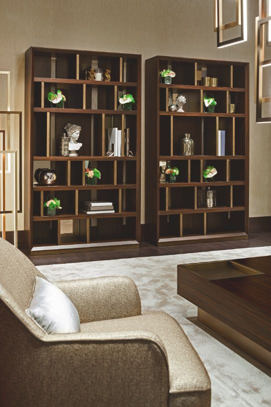 "The ""Symphony in Beige"" living room by Oasis features two big Magritte bookshelves, perfect for book of any size."