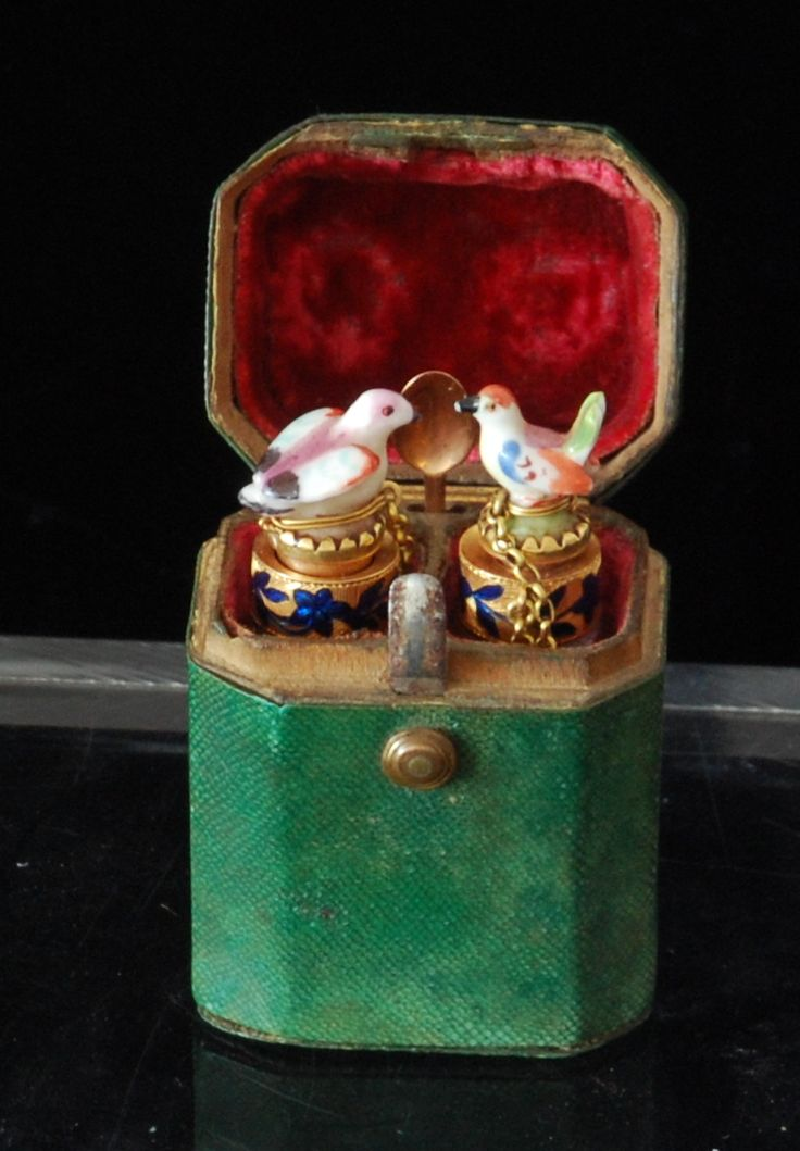 Pair of rock-crystal scent bottles with enamelled gold mounts and Chelsea porcelain stoppers; original shagreen case.