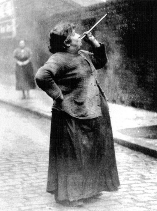 A forgotten profession: In the days before alarm clocks were widely affordable, people like Mary Smith of Brenton Street were employed to rouse sleeping people in the early hours of the morning. They were commonly known as 'knocker-ups' or 'knocker-uppers'. Mrs. Smith was paid sixpence a week to shoot dried peas at market workers' windows in Limehouse Fields, London. Photograph from Philip Davies' Lost London: 1870-1945.: