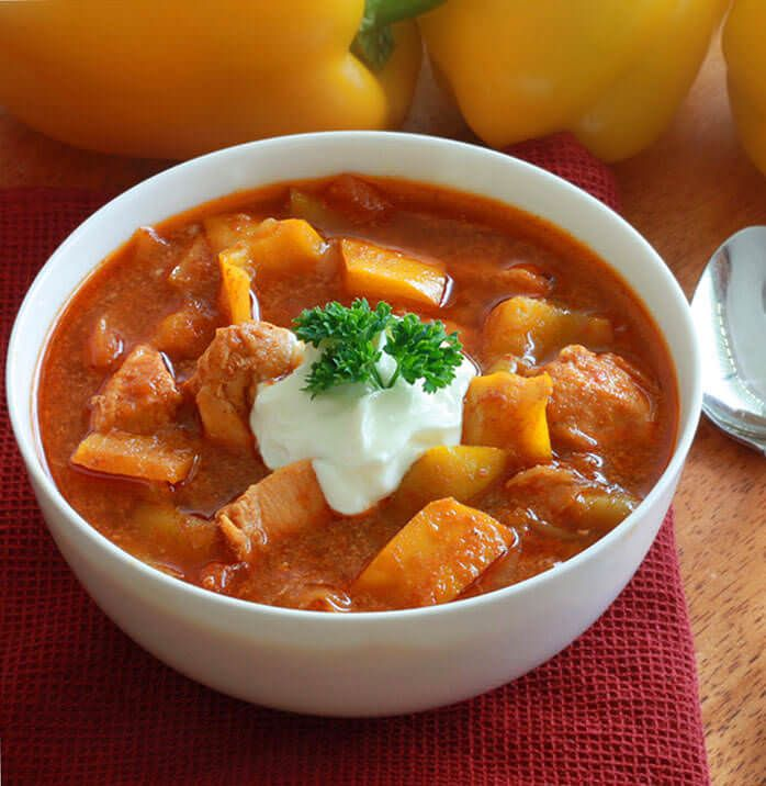 This chicken goulash is cooked after traditional Hungarian fashion. A few simple ingredients yields an amazing depth of flavor. Sure to be a favorite.