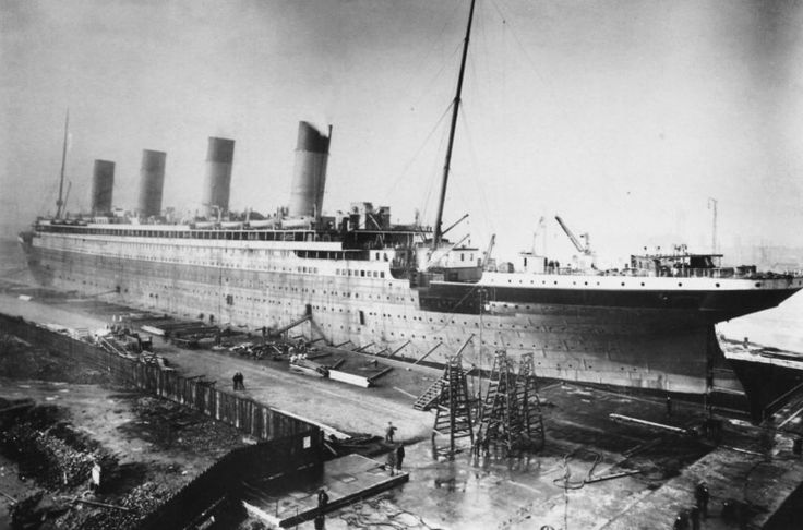 Titanic after being fitted with 3 functional and 1 dummy funnel at the Harland & Wolff fitting quay.