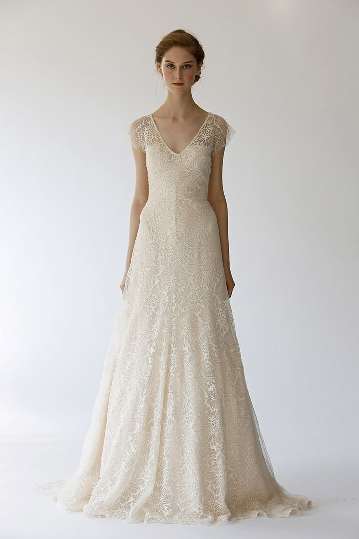 A Romantic Gown Of Floral Lace And Layered Over Soft Blush